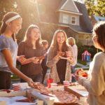 enjoying pizza at a neighborhood get together