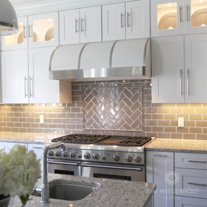 Glass subway tiles with herringbone section