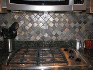 metal and slate mosaic tile backsplash