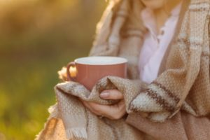 cup-sunset-hand-young-girl-covered-with-blanket