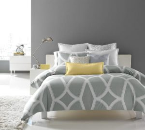 Gray bedroom with bright yellow pillow