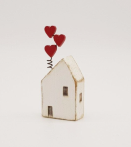 little wood house with hearts